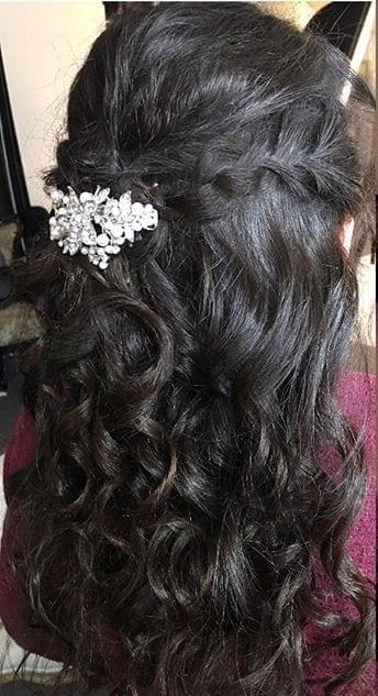 Black hair with braid half down hair style